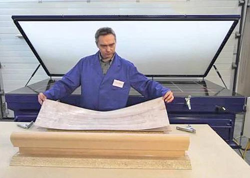 laying-down-a-paper-print-for-wet-mounting-under-a-vacuum-press