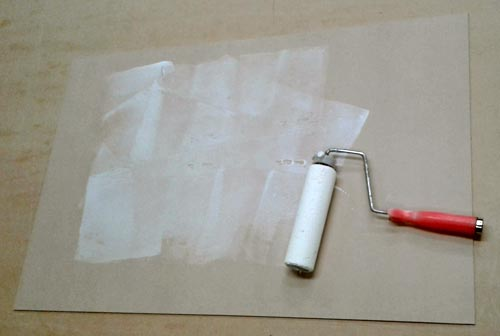 picture-framing-wet-mounting-rolling-glue-with-a-paint-roller-before-vacuum-pressing-st-1st-stage