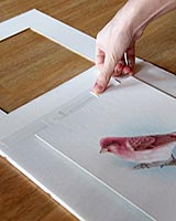 hinging-art-to-picture-frame-window-mat