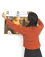 levelling-a-picture-frame-on-a-wall